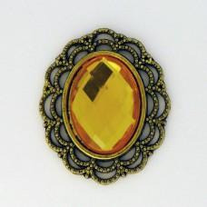Брошь в бронзовой оправе желтая